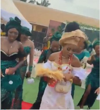 Bridesmaid's breast takes centre stage,as guest spray money on her instead of on bride (video)