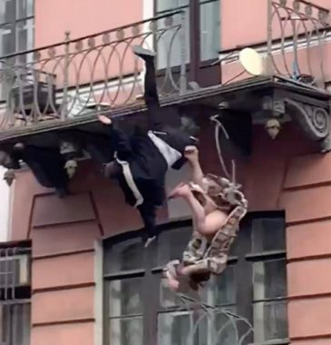 Terrifying moment couple fall off balcony while arguing (Sensitive Video)